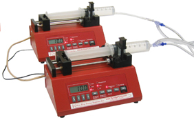 dual syringe pumps for continuous pumping on a programmed schedule